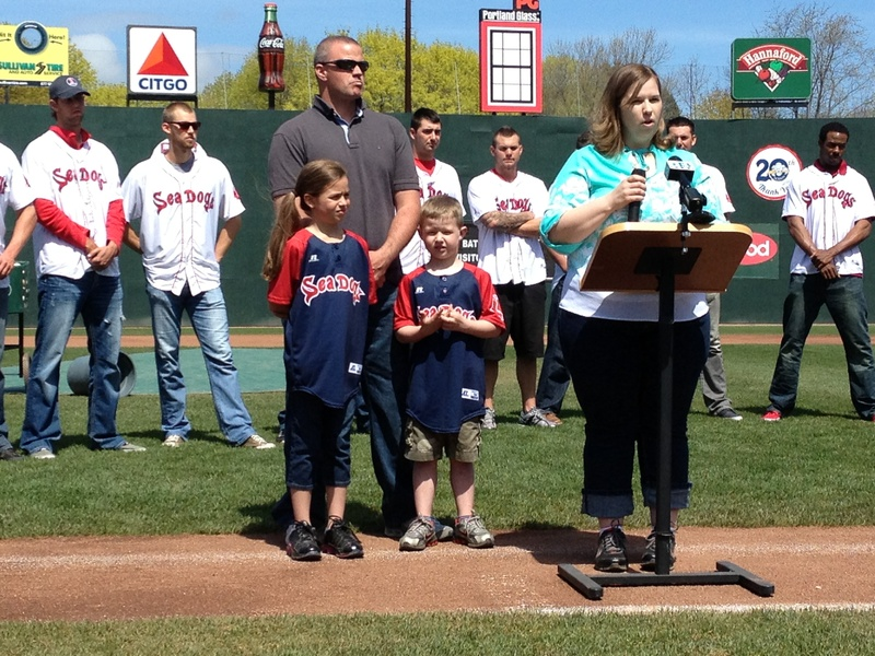 The family of 7-year-old Nate Gallant of Mexico, including father Kevin, mother Heather and sister Gabby, 9, promotes the 19th Strike Out Cancer in Kids program, the signature charity of the Sea Dogs, at Hadlock Field on Wednesday.