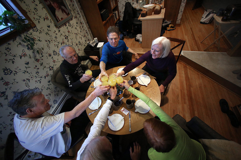 The runners celebrate their tradition with a toast, including from bottom right, Sheila Cole, Dan Cole, Jim Martin, Jim Patrykus, Jeff Grosscup and Karin Grosscup.