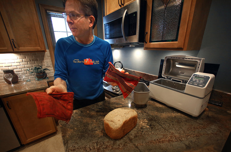 Jeff Grosscup takes a fresh loaf of bread out of his bread-making machine.