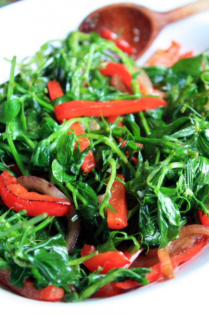 Fresh peas offer green options through spring and well into summer. At right, an early-season application: Pea shoots with red peppers and red onion.