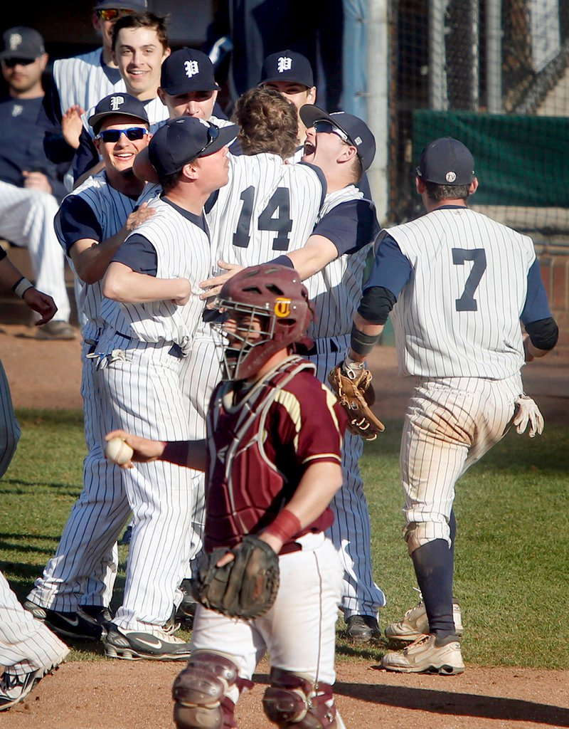 Tim Rovnak of Portland is welcomed by teammates Tuesday after hitting a two-run inside-the-park homer against Thornton Academy. The catcher is Josh Coffin.
