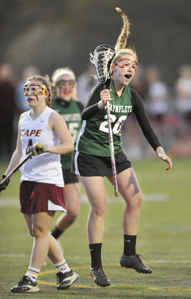 Cat Johnson of Waynflete reacts Wednesday night after scoring in the 10-8 victory against Cape Elizabeth in a game between unbeaten girls' lacrosse teams.