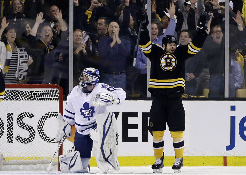 Nathan Horton of the Boston Bruins celebrates his first-period goal Wednesday night, starting his team to a 4-1 victory against the Toronto Maple Leafs in their playoff opener. The Toronto goalie is James Reimer.