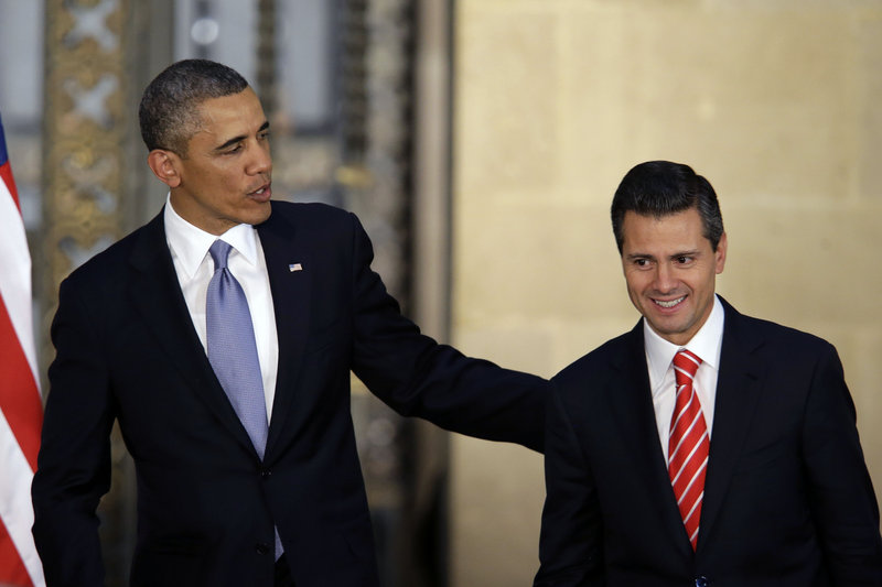 President Obama and Mexico's President Enrique Pena Nieto leave a joint news conference in Mexico City, Mexico, on Thursday. Obama is promoting jobs and trade – not drug wars or border security – as the driving force behind the U.S.-Mexico relationship.