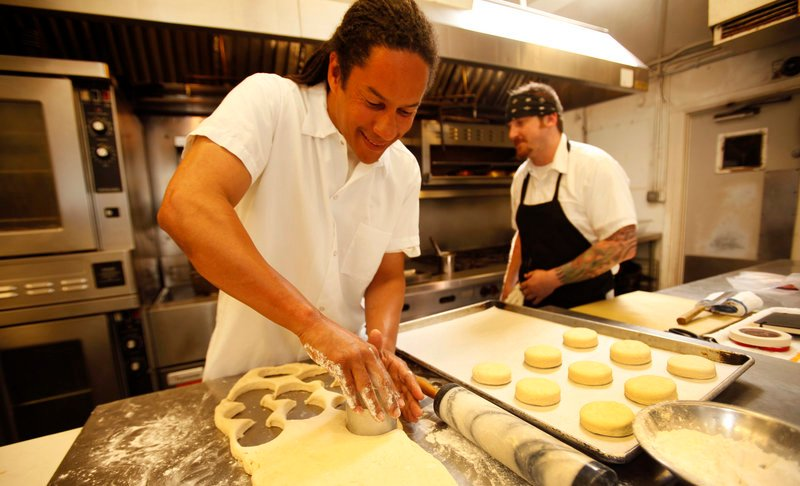 Chef Govind Armstrong, above, makes biscuits at his restaurant Willie Jane in Venice, Calif.