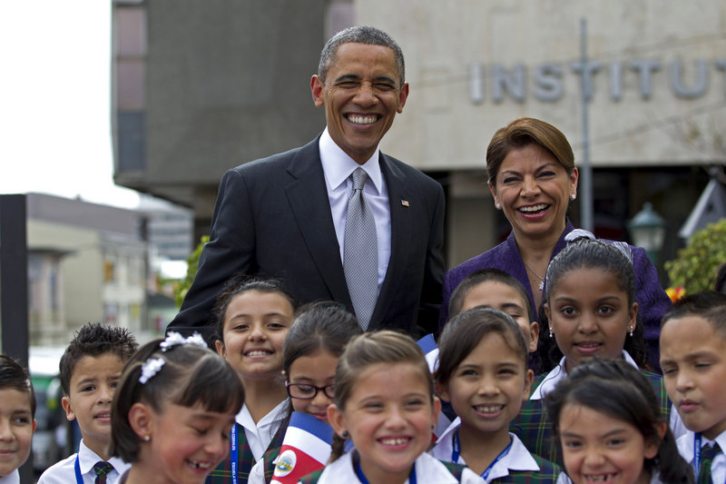 President Obama and Costa Rican President Laura Chinchilla pose for photos with a group of students upon his arrival at the foreign ministry in San Jose on Friday.