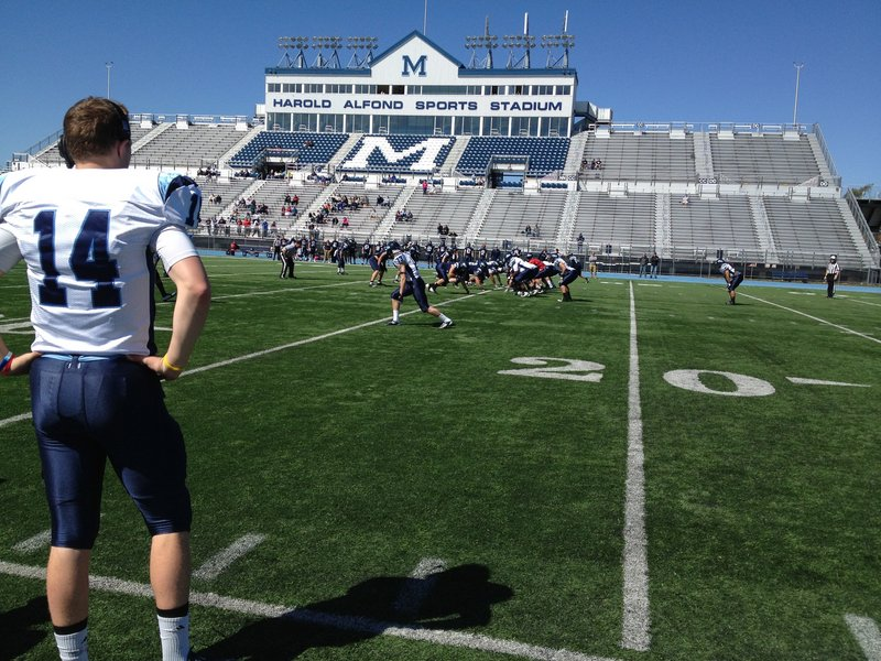 Backup quarterback Daniel Collins looks on Saturday after signaling a play during the annual University of Maine spring football scrimmage in Orono.