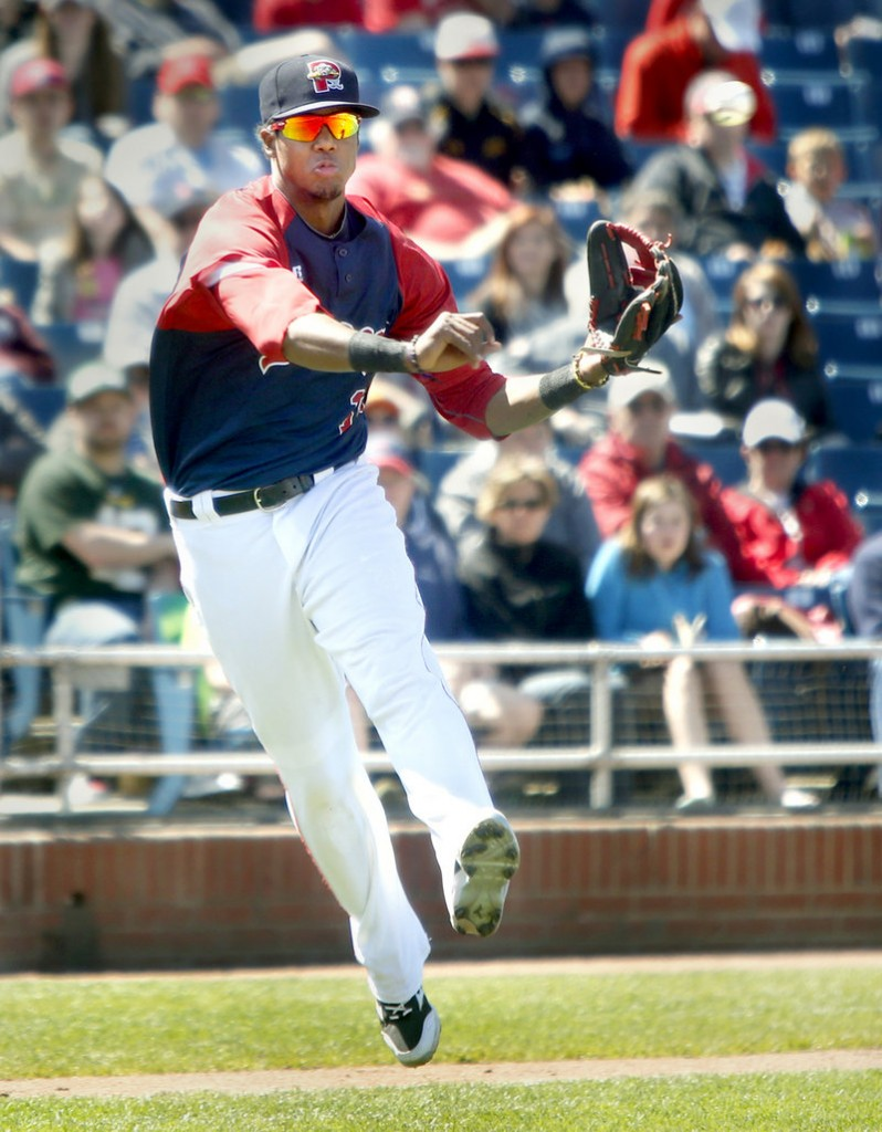 Portland's Michael Almanzar fires the ball to first base after fielding a bunt against the Rock Cats on Sunday. Almanzar's throw, however, was off the mark for an error.
