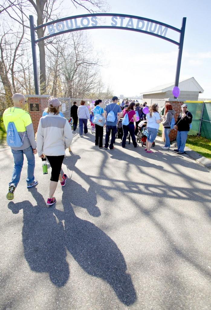 Walkers head down to Baxter Boulevard at the start of the March of Dimes March for Babies event at Cheverus High School on Sunday morning in Portland.