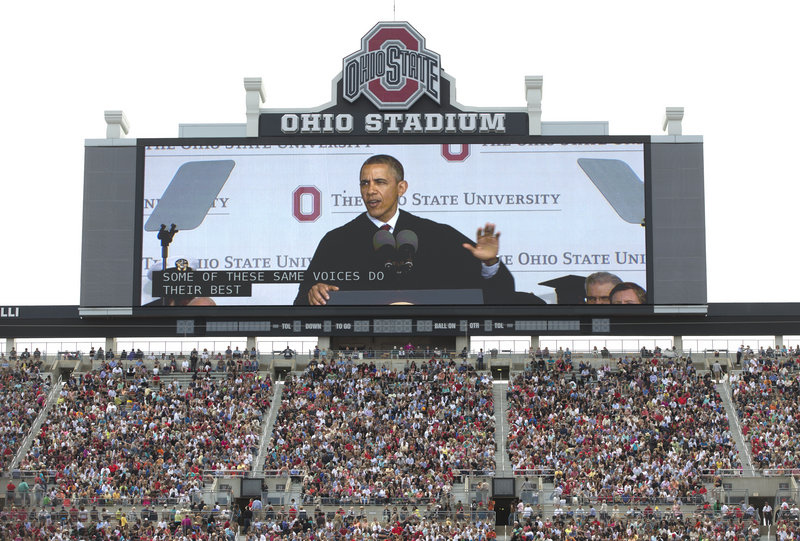 President Obama is seen on a video screen as he speaks during the Ohio State University spring commencement in the Ohio Stadium on Sunday in Columbus, Ohio. Obama encouraged graduates to participate in public life.
