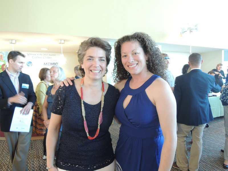 Lori Voornas from radio station Q97.9, left, the volunteer emcee for the silent auction, and Jen Libby of Falmouth