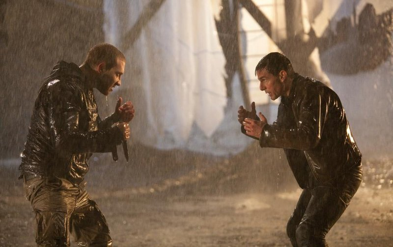 "Jai Courtney, left, faces off against Tom Cruise in ""Jack Reacher."""