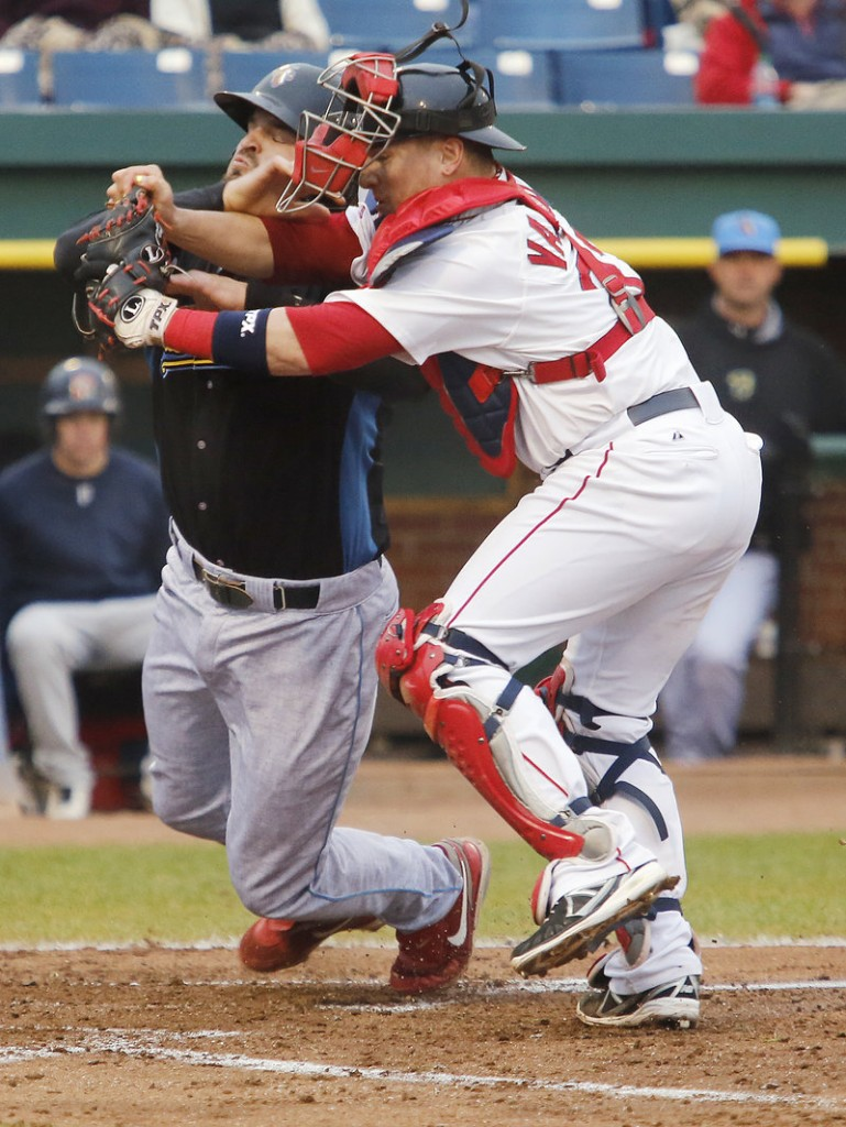Portland catcher Christian Vazquez holds onto the ball while tagging Reading's Jim Murphy to end the fourth inning of Monday's game in Portland, won by the Sea Dogs.