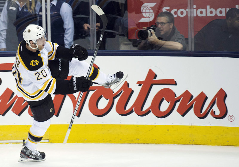 Boston Bruins forward Daniel Paille celebrates a third-period goal against the Toronto Maple Leafs Monday night in Toronto. With the victory, the Bruins took a 2-1 lead in the best-of-seven opening-round series.