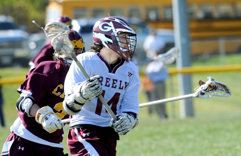 Brooks Belisle of Greely looks to move toward goal Tuesday while being chased by Brandon Negele of Cape Elizabeth during the Capers' 8-4 victory in a showdown of Western Class B boys' lacrosse powers.