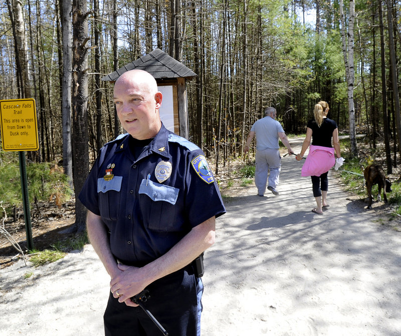 "Saco Deputy Police Chief Jeff Holland, seen at Cascade Falls Thursday, said police are checking for ""suspicious and illicit behavior"" in the family-friendly park."