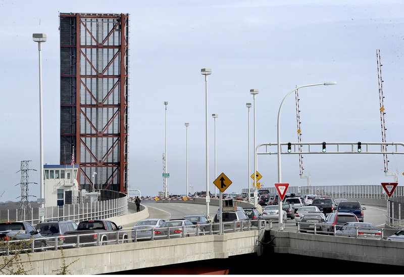 The northbound lanes sit empty during rush hour Wednesday after one of two lifts on that side of the Casco Bay Bridge got stuck in the up position. Meanwhile, traffic heading to South Portland backs up as police re-routed northbound drivers into the southbound lanes.