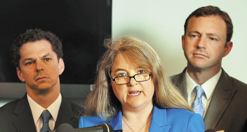 Sen. Rebecca Millett, with Sen. Justin Alfond, left, and Rep. Mark Eves, announce a Democratic plan to grade Maine schools during a State House news conference Wednesday in Augusta.