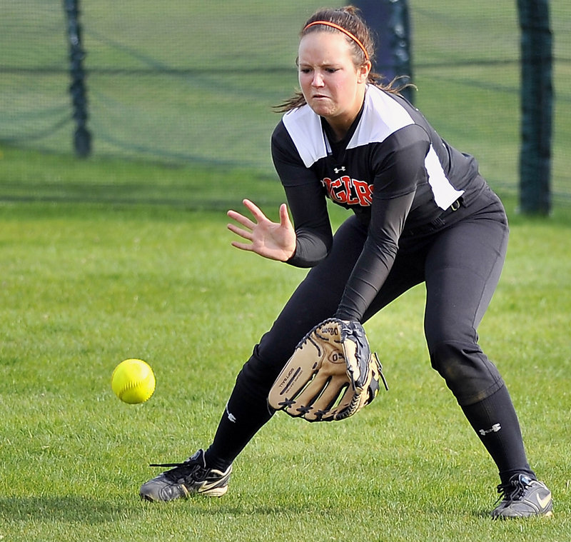 Sara Scott fields a ball hit to center during Biddeford's 5-3 win over Cheverus on May 8 – one of two close victories that helped the Tigers keep alive what is now a nine-game winning streak.