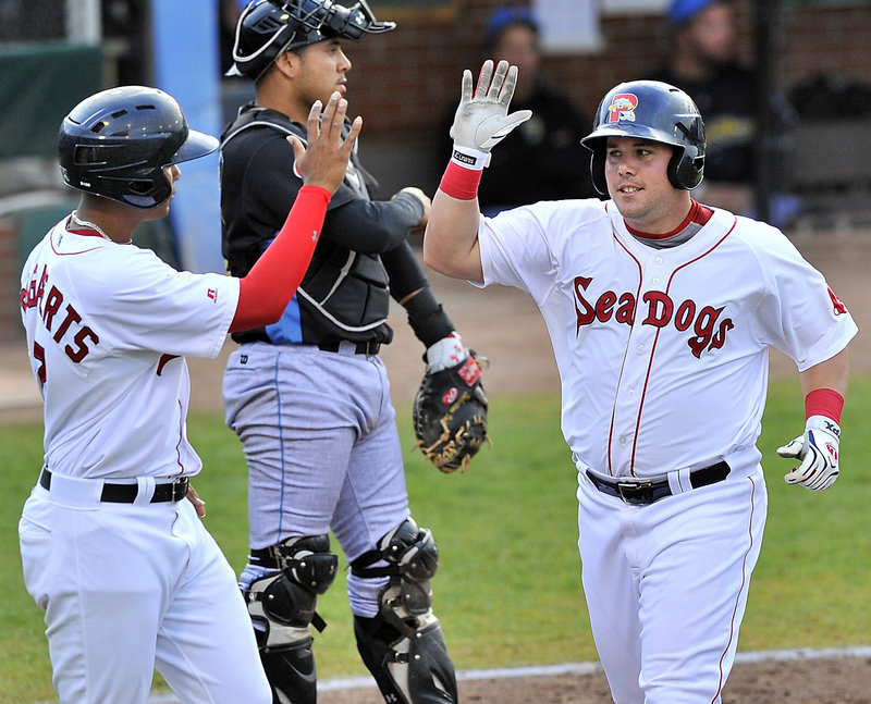 J.C. Linares of the Portland Sea Dogs, right, is welcomed by Xander Bogaerts after both scored in the fifth inning Wednesday – all part of a 10-4 win over Reading.