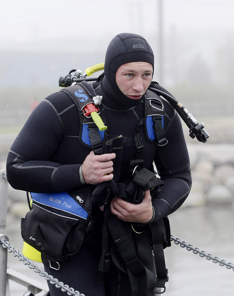A.J. Nelson of the South Portland Dive Team prepares to go out for training in Portland Harbor on Thursday.