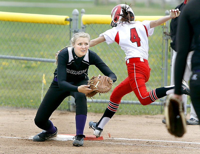 Kelsey Morton of South Portland is late to the bag as Marshwood first baseman Johnna Kashmer takes the throw Friday during Marshwood's 4-3 victory.