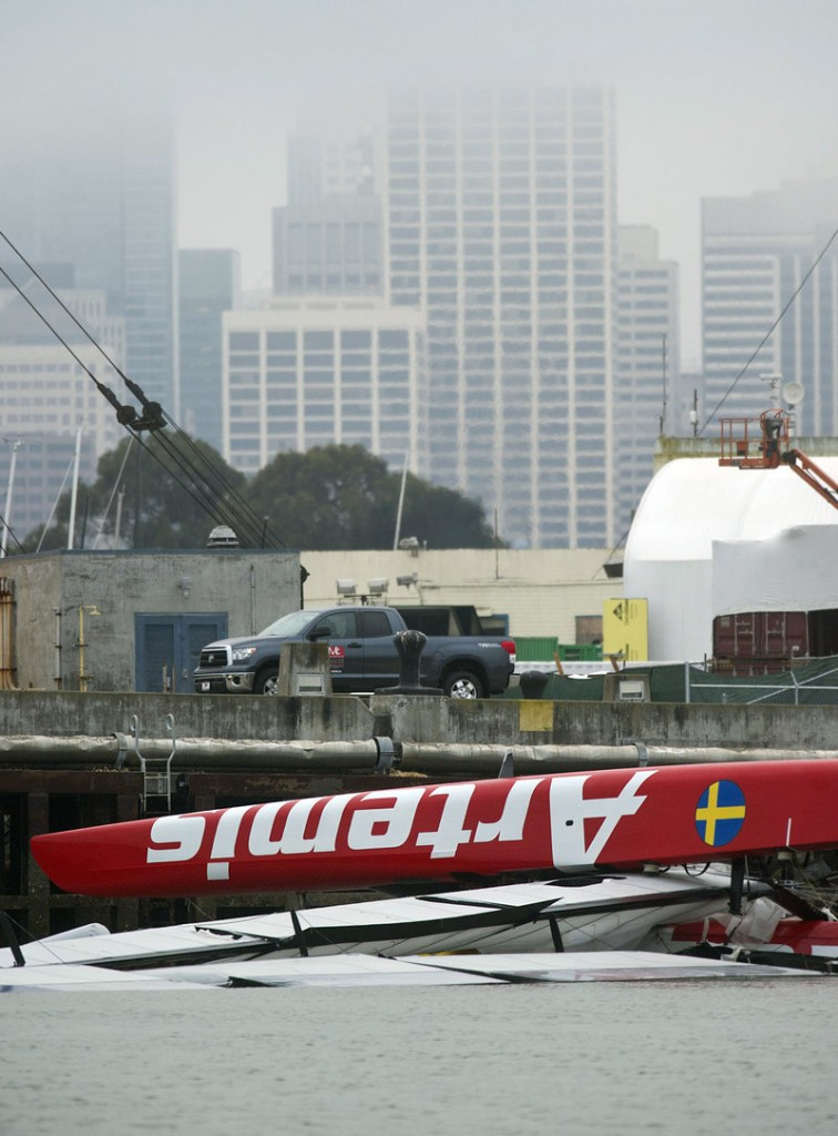 """The Artemis catamaran floats upside down Friday in San Francisco, a day after sailor Andrew """"Bart"""" Simpson died in the capsize."""