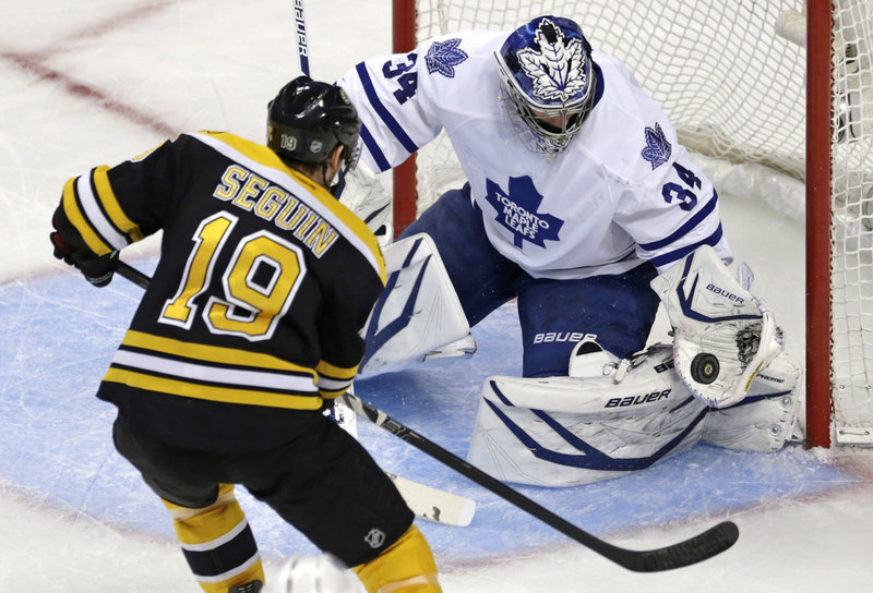 Boston forward Tyler Seguin is foiled by Toronto goaltender James Reimer's catching glove during first-period action of Friday's playoff game in Boston, won by the Maple Leafs and setting up Game 6 on Sunday.
