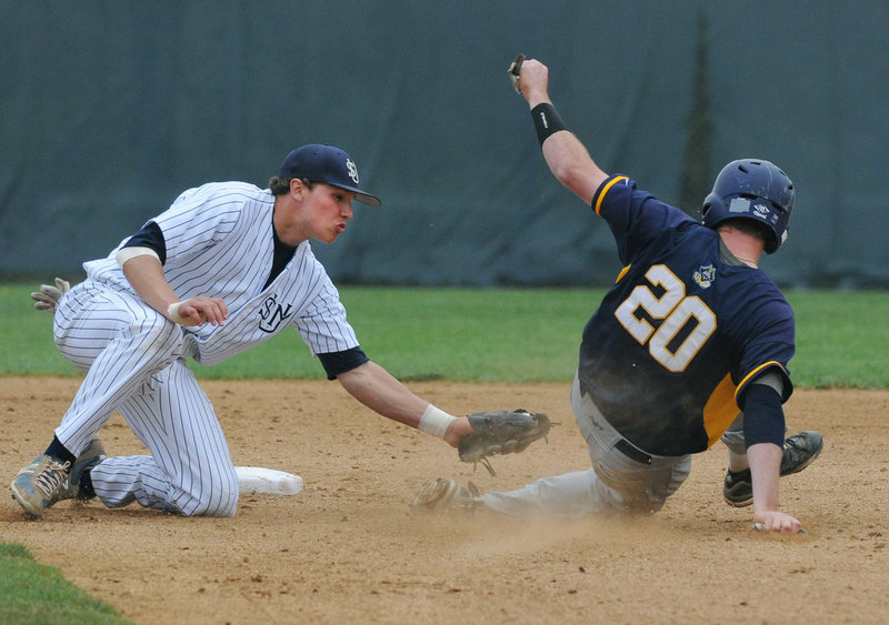 Sam Dexter, the University of Southern Maine shortstop, puts the tag on Corey Allison of UMass-Dartmouth, who was nabbed at second after being picked off first base in the second inning Saturday. USM won 4-2 and will learn Sunday who and where it will play in the NCAA regionals.