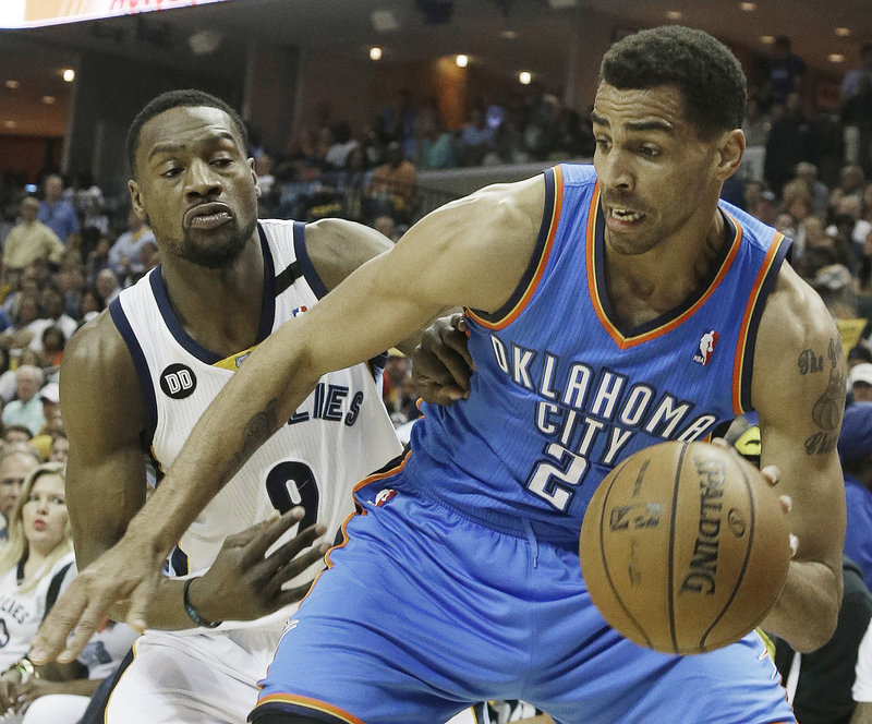 Thabo Sefolosha of the Oklahoma City Thunder moves the ball against Tony Allen of the Memphis Grizzlies during the first half of the Grizzlies' 87-81 victory Saturday.