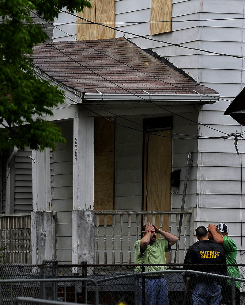 Sheriff's department workers board up the home of kidnapping suspect Ariel Castro at 2207 Seymour Ave. in Cleveland after FBI personnel removed several items Friday.