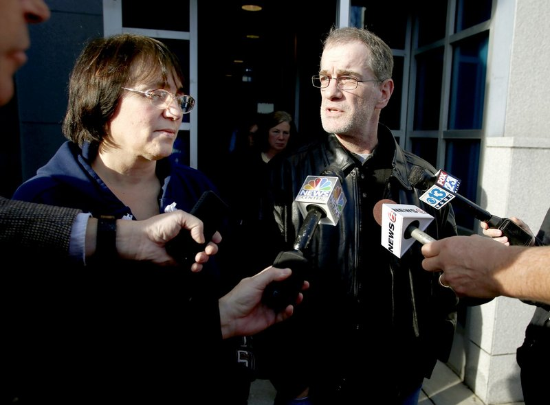 In this Jan. 14, 2013 file photo, Renee Sandora's mother, Patricia Gerber, and her step-father, Mark Gerber, meet with reporters outside the Cumberland County Courthouse after Joel Hayden was found guilty of killing Sandora, the mother of his four children.