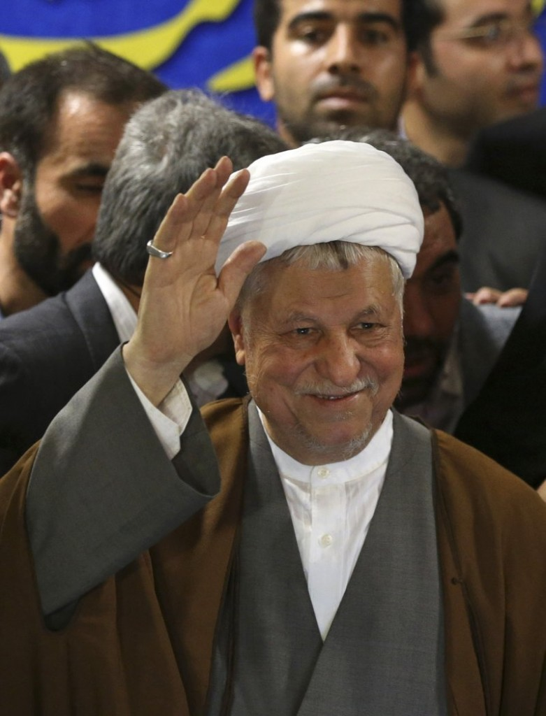 Former President Akbar Hashemi Rafsanjani waves as he registers his candidacy for the presidential election.