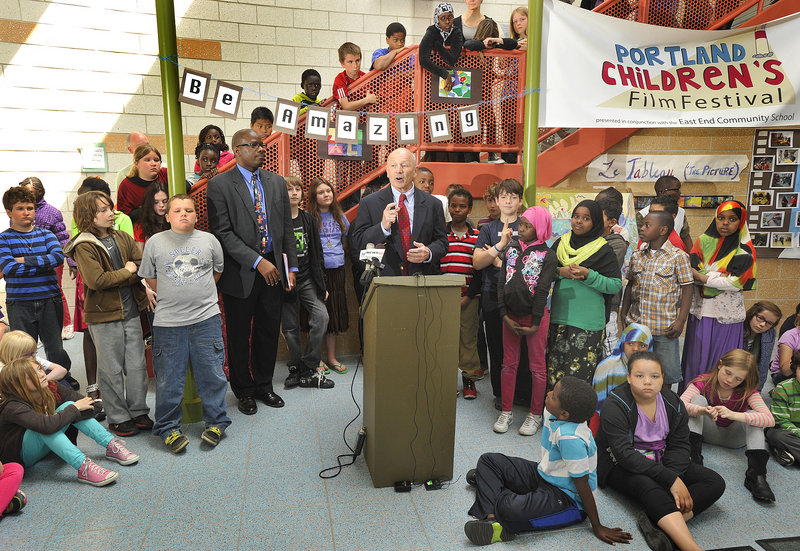 Portland School Superintendent Emmanuel Caulk, left, joins with Mayor Michael Brennan to encourage voters to approve the school budget in Tuesday's referendum. They held a news conference at the East End School on Munjoy Hill, with students on hand to watch.