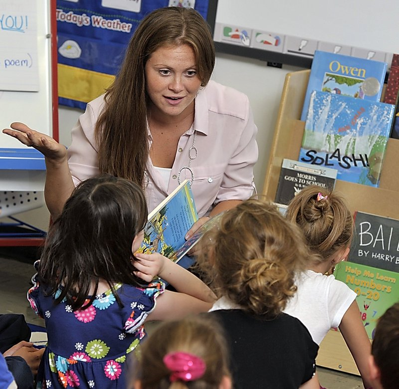"""First-grade teacher Ashley Martin discusses the book """"The Circus Ship"""" with her students at Coffin Elementary School in Brunswick last fall. A reader says that Gov. LePage's criticism of public school teachers shows a lack of respect """"for a profession so necessary to the fabric of the republic."""""""