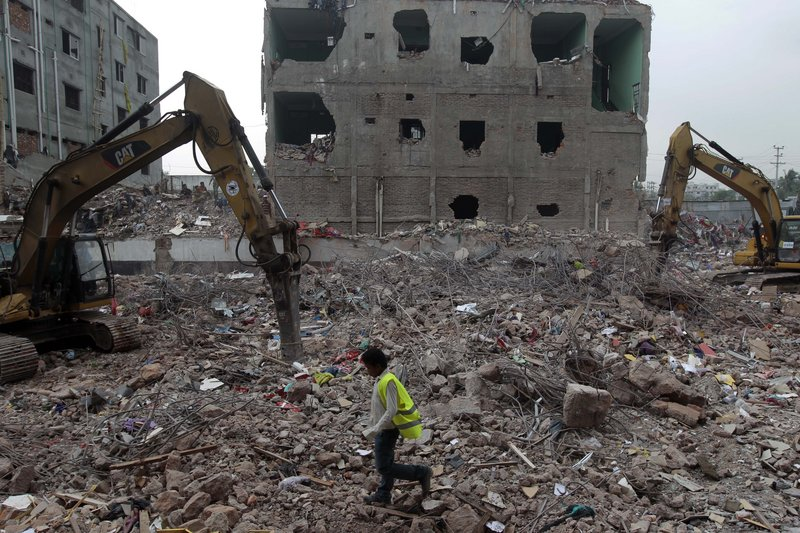 A Bangladeshi rescue worker walks at the site where a garment factory building collapsed on April 24 in Savar, near Dhaka, Bangladesh, on Monday. Nearly three weeks after the building collapse, the search for the dead ended Monday at the site of the worst disaster in the history of the global garment industry.