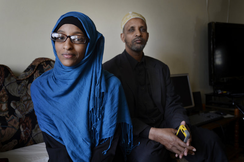 Deering High School junior Sahara Hassan, 17, at home with her father, Mohamed Hassan, said it's unlikely she would have done anything about college if not for Make it Happen!