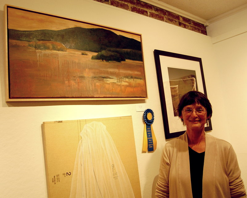 "Judith Schuppien with her best-in-show painting, ""Isle au Haut."""