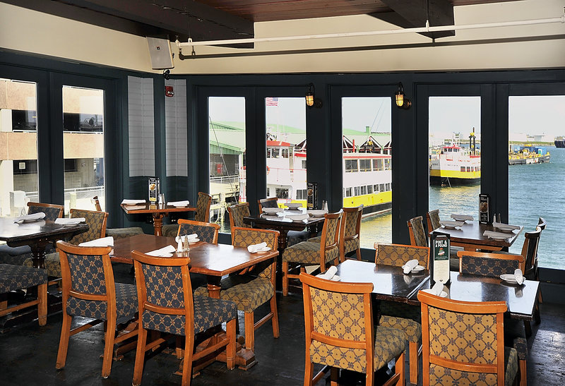The upstairs dining room at RiRa overlooks Portland Harbor and the fleet of ferries operated by Casco Bay Lines.