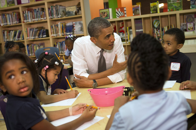 "President Obama talks to a class of pre-kindergarten schoolchildren at Moravia Park Elementary School in Baltimore, Md., on Friday during the his second ""Middle Class Jobs and Opportunity Tour."""