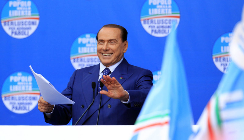 Silvio Berlusconi speaks May 11 in Brescia. In a separate trial from that of his three former aides, he is charged with paying for sex with a minor and trying to cover it up.