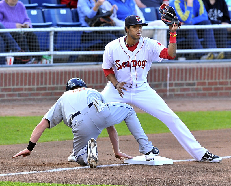 Portland third baseman Michael Almanzar can't tag out Binghamton's Blake Forsythe, who avoids a pickoff attempt.