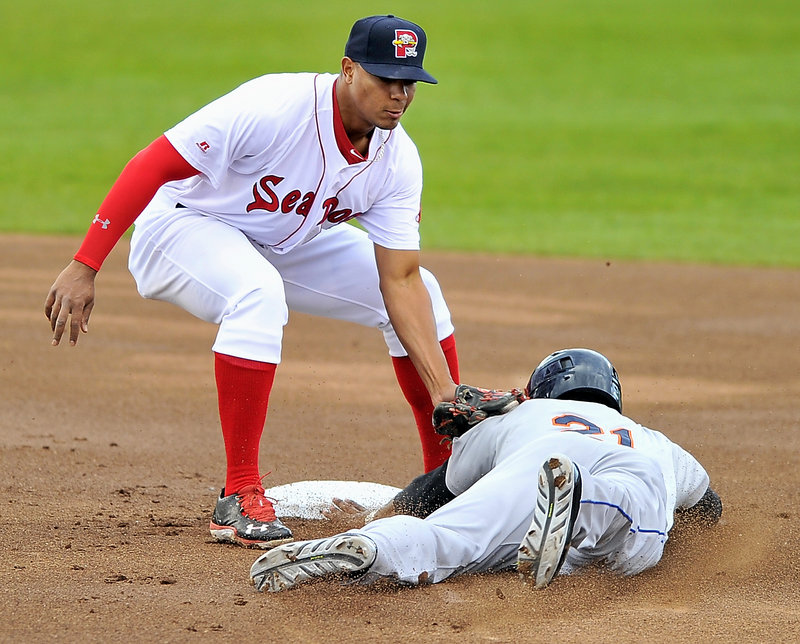 Portland shortstop Xander Bogaerts tags Binghamton's Cesar Puello as he tries to steal second base during Friday's game at Hadlock Field, won by the Mets.