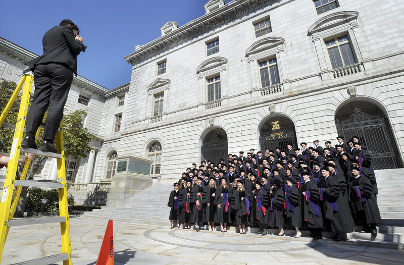 Lana Citowsky takes a photo of University of Maine School of Law graduates in Portland on Saturday.