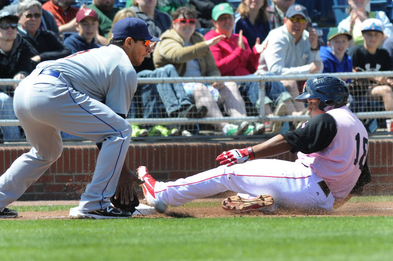 Portland's Heiker Meneses slides safely into third base ahead of the throw to Binghamton infielder Josh Rodriguez during Saturday's game at Hadlock Field, won by the Sea Dogs 10-7 in dramatic fashion.