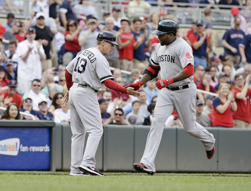 David Ortiz is greeted by third-base coach Brian Butterfield after hitting a three-run homer in the first inning Saturday night against the Twins.