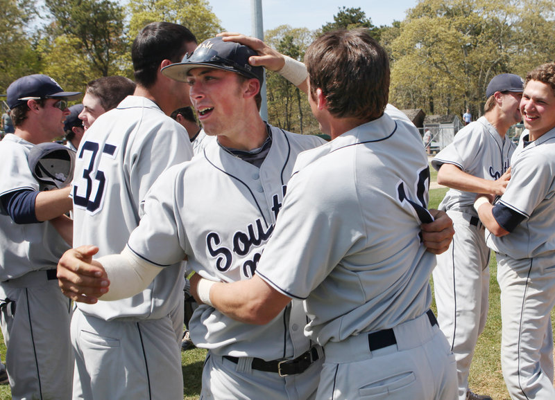 Nick Grady, left, and Troy Thibodeau are all smiles during Sunday's celebration of their regional tournament victory.