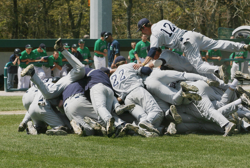 It's a pile of joy for the USM baseball team following Sunday's rout of Endicott College in the NCAA Division III New England tournament in Harwich, Mass. Now it's on to next weekend's national tournament for Coach Ed Flaherty's Huskies.