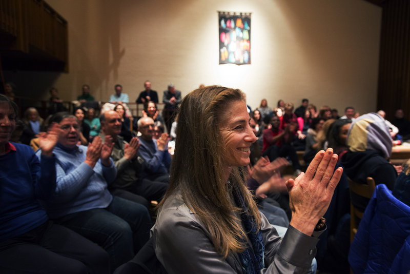 Tara Brach applauds a music performance at the Maryland church where she holds a weekly meditation class.