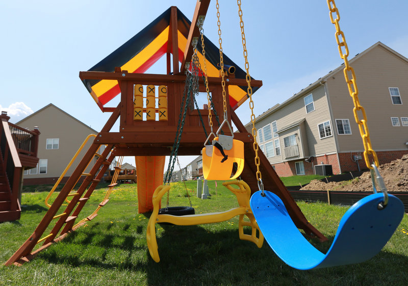 "A play set called ""The Carnival"" graces a backyard in Novi, Mich. Before selecting a design online or from a catalog, ""You've got to come into the showroom and let the kids test it out,"" says Dave Byrum of Kids Gotta Play."